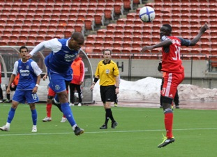 FC Edmonton's Conrad Smith gets his head to the ball in front of Toronto FC's Dicoy Williams. JOHN TURNER PHOTO