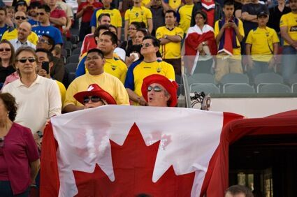 Canadian fans try to stand out in a sea of Ecuador yellow. PHOTO: KANISHKA SONNADARA