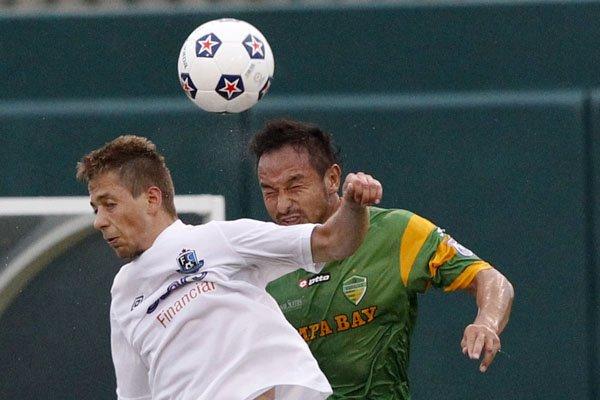 FCE's Alex Semenets in action against FCTB's Takuya Yamada. PHOTO: NASL