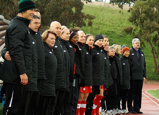 The Canadian team stands for the anthem
