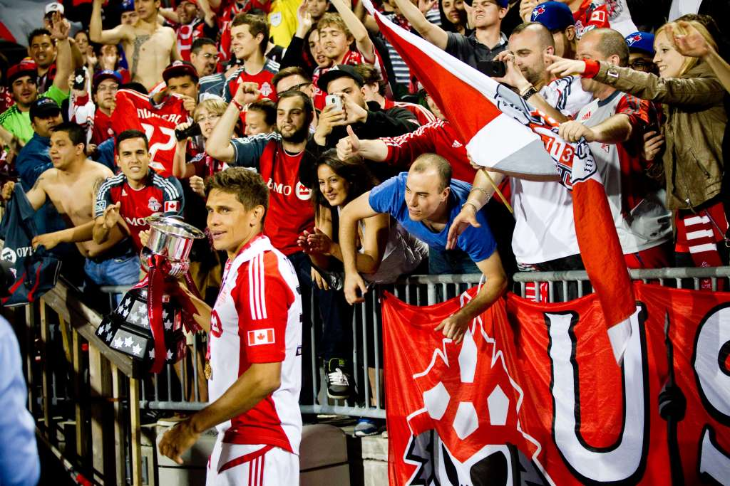 Adrian Cann celebrates the win with TFC supporters. PHOTO: CANADA SOCCER/JESSICA BOTTS