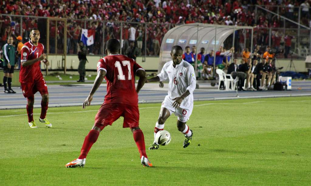 Canada's Julian de Guzman, right, tries to carry the ball past Panama's Luis Henriquez. PHOTO: CANADA SOCCER