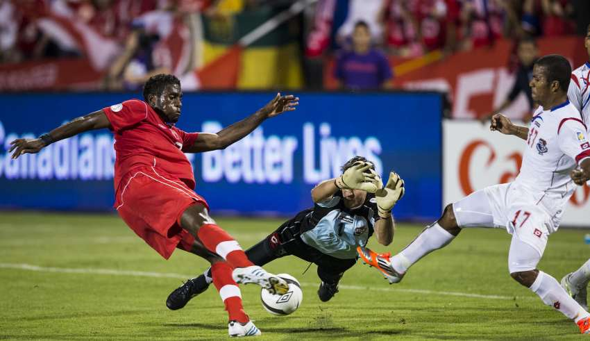 Panama's Jaime Penedo dives to try and stop Olivier Occean's effort. PHOTO: CANADA SOCCER/PAUL GIAMOU