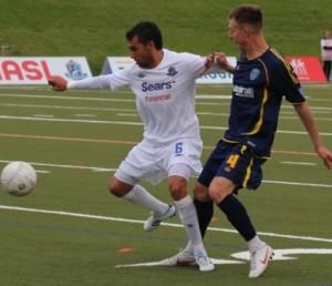 FC Edmonton midfielder Shaun Saiko battles against Minnesota's Neil Hlavaty. JOHN TURNER PHOTO