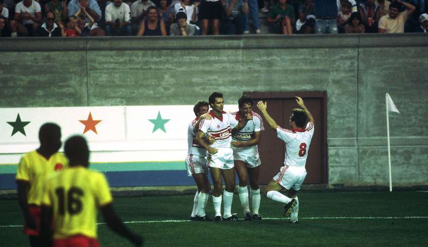 Dale Mitchell, second from left, is mobbed by teammates after scoring a goal at the 1984 Olympics.