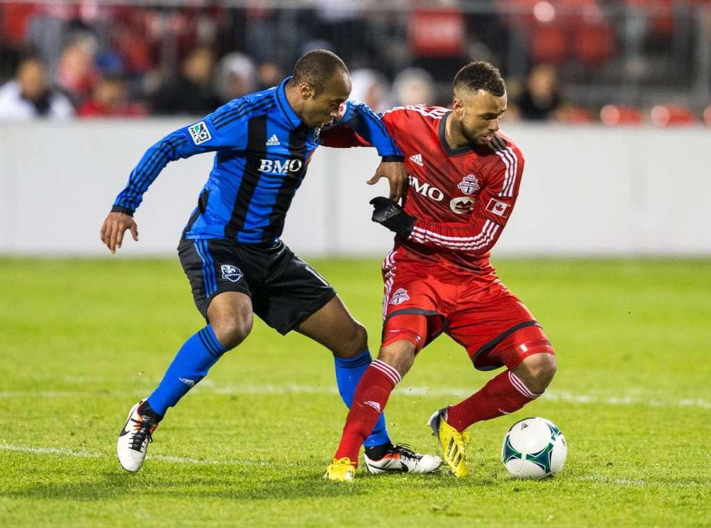 Montreal's Sanna Nyassi takes on TFC's John Rostock. PHOTO: CANADA SOCCER