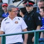 Gunter Kronsteiner escorted out of Clarke Stadium by the Edmonton Police Service. PHOTO: TONY LEWIS/FC EDMONTON