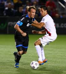 FC Edmonton's Albert Watson tries to get around Atlanta's Pedro Mendes.
