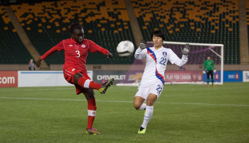 Canada's Sura Yekka kicks the ball away from South Korea's Minji Yeo. PHOTO: TONY LEWIS/CANADA SOCCER