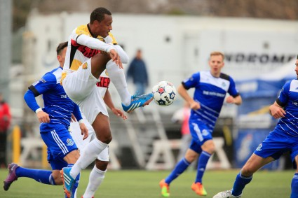 Chris Nurse, in white, was able to enjoy some revenge on his former FCE teammates. PHOTO: FC EDMONTON/TONY LEWIS