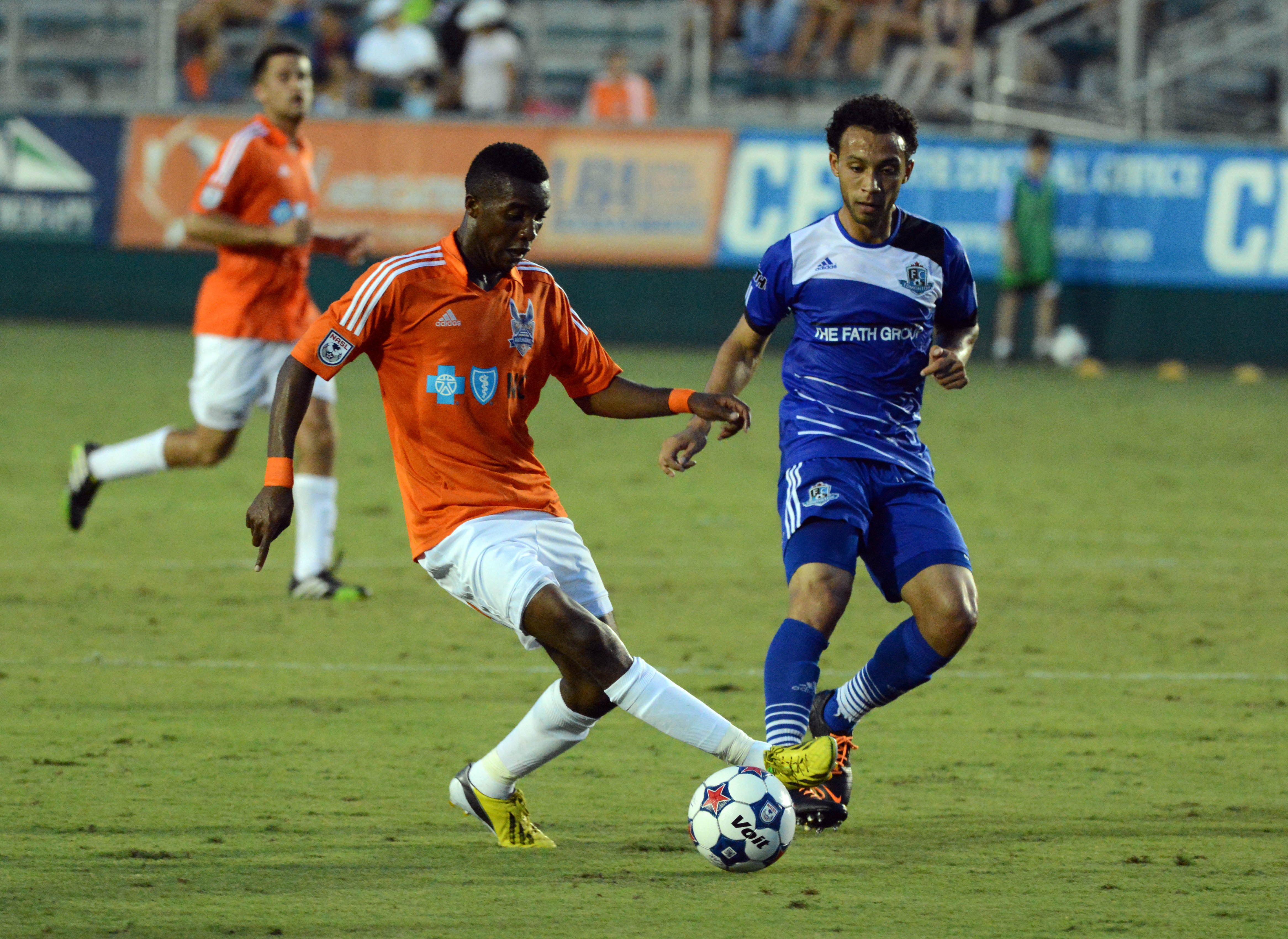 Carolina's Ty Shipalane tries to evade FCE's Cristian Raudales. PHOTO: ROB KINNAN