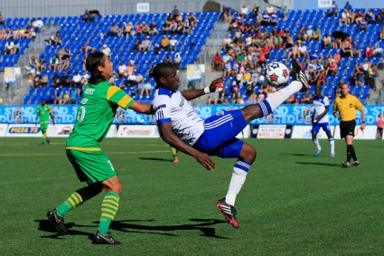 Kareem Moses, right, clears a ball away from the path of Tampa Bay's Willie Hunt. FC EDMONTON/TONY LEWIS