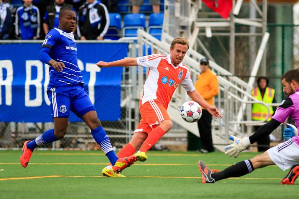 Matt Van Oekel, right, robs Carolina's Mark Anderson as FCE defender Mallan Roberts tries to get a foot in. PHOTO: FC EDMONTON/TONY LEWIS