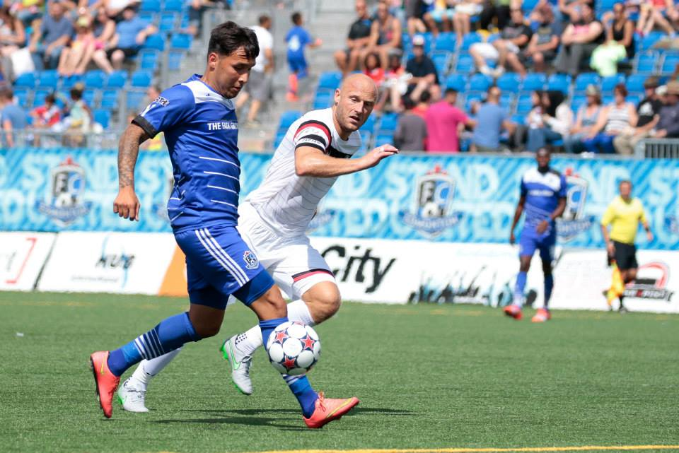 FCE's Sadi Jalali is challenged by Atlanta's Simon Mensing. PHOTO: TONY LEWIS/FC EDMONTON