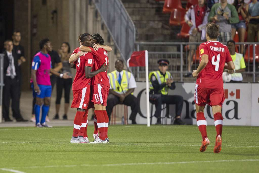 Tosaint Ricketts is congratulated after scoring. PHOTO: PAUL GIAMOU/CANADA SOCCER