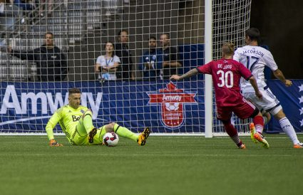 Marcel de Jong is stopped by Whitecaps keeper Paolo Tornaghi. PHOTO: CANADA SOCCER/BOB FRID