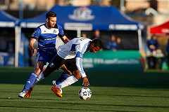 From the 2014 Voyageurs Cup semifinal: FC Edmonton's Ritchie Jones challenges' the Impact's Patrice Bernier. The Impact came within seconds of being eliminated by the Eddies.