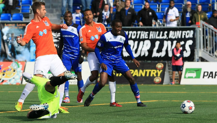 FCE's Tomi Ameobi (centre) gets set to celebrate as the ball slides by Carolina keeper Akira Fitzgerald. PHOTO: TONY LEWIS/FC EDMONTON