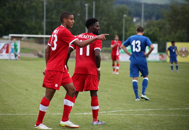 Tesho Akindele and Tosaint Ricketts celebrate a goal against Azerbaijan. PHOTO: CANADA SOCCER