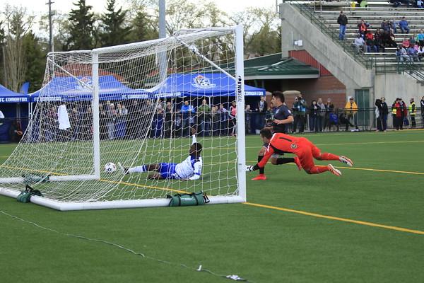 Tomi Ameobi scores for the Eddies as Minnesota keeper Mitch Hildebrandt scrambles in vain. PHOTO: TONY LEWIS/FC EDMONTON