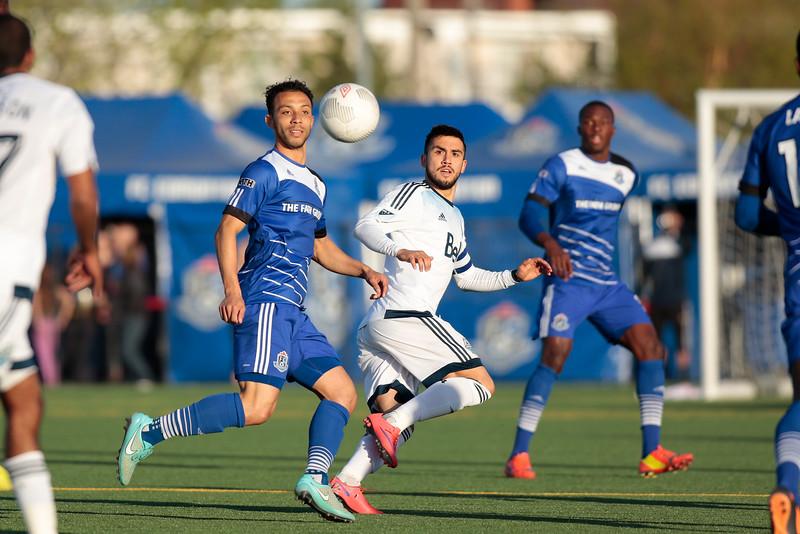 FC Edmonton's Cristian Raudales heads the ball away from Whitecap Pedro Morales. PHOTO: TONY LEWIS/FC EDMONTON