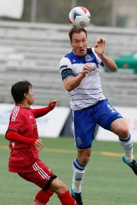 Albert Watson heads the ball in action against Ottawa. PHOTO: FC EDMONTON/TONY LEWIS