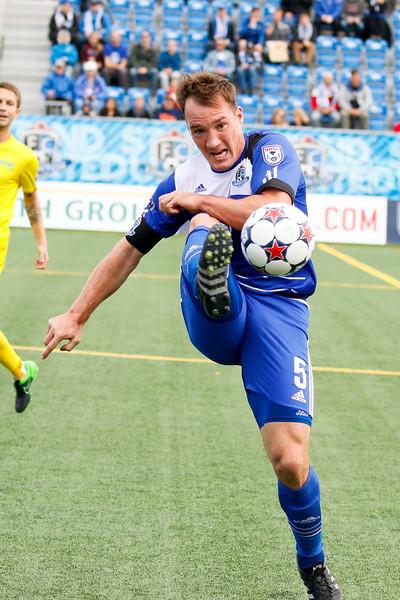 Albert Watson on the volley. PHOTO: FC EDMONTON/TONY LEWIS