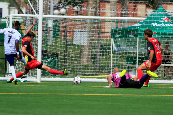 Horace James scores the opening goal after a howler from Scorpions' keeper Josh Saunders. PHOTO: FC EDMONTON/TONY LEWIS