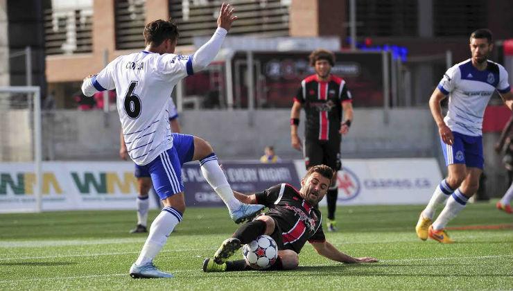 The Fury's Sinisa Ubiparipovic wins the ball from FCE's Dustin Corea.