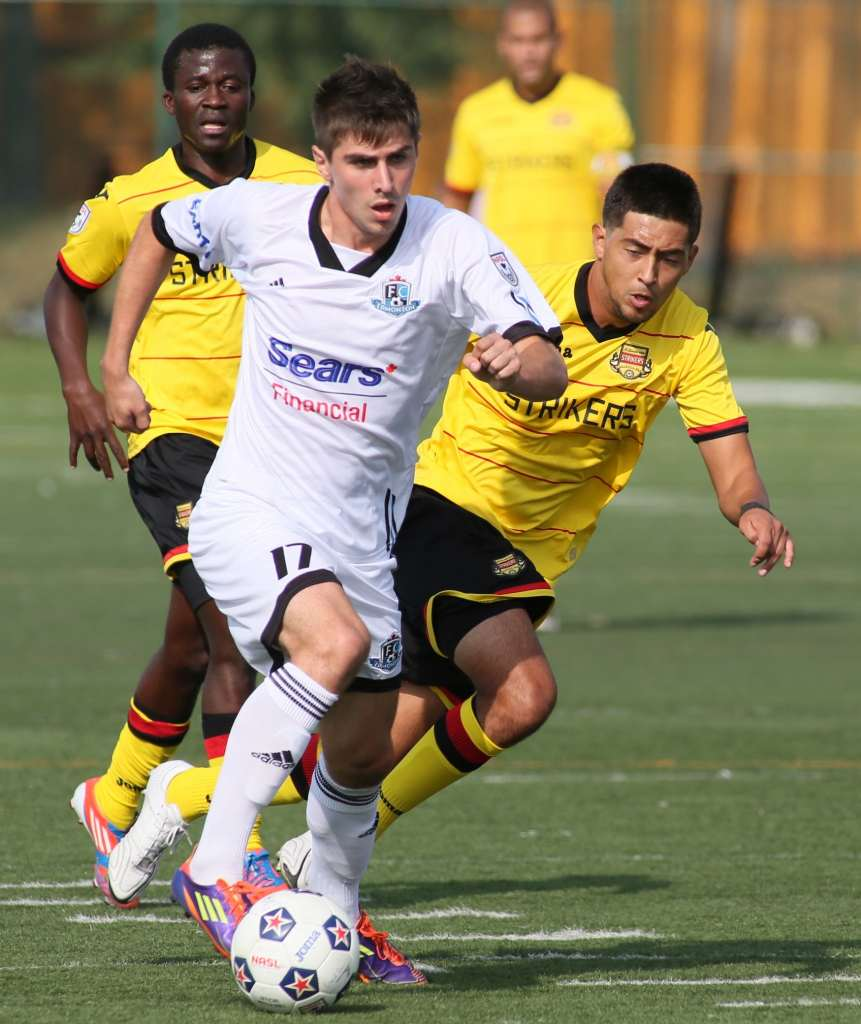 FCE's Elvir Gigolaj, in white, in action against the Strikers. PHOTO: FC EDMONTON