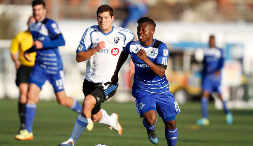 FCE's Hanson Boakai pulls away from the Impact's Karl Ouimette. PHOTO: TONY LEWIS/FC EDMONTON