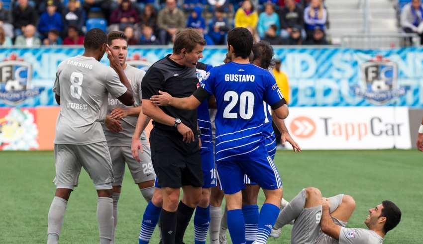Chris Nurse, left, says a racist epithet was launched at him. PHOTO: TONY LEWIS/FC EDMONTON