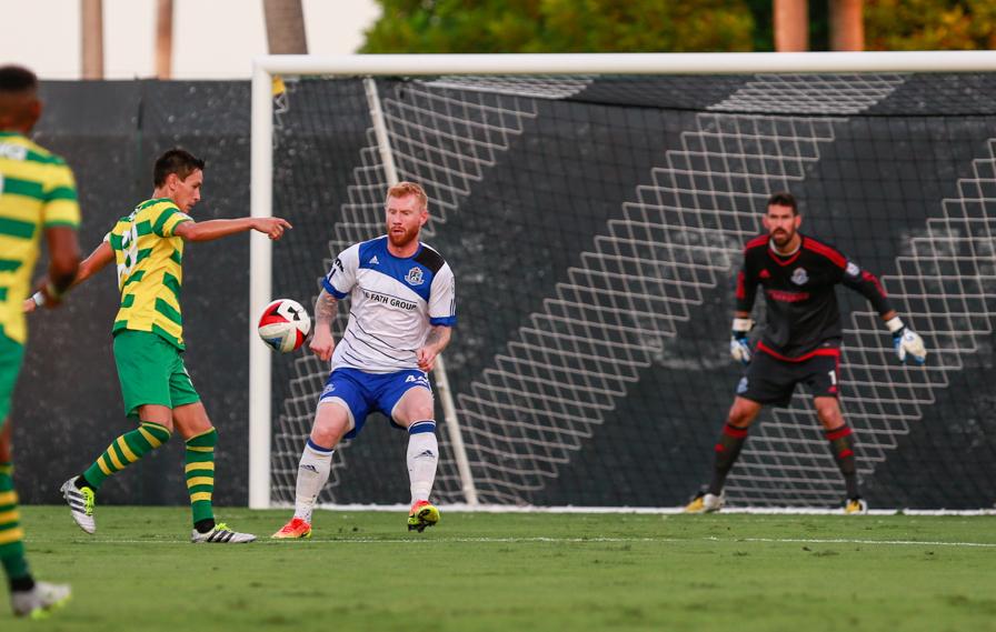 Adam Eckersley and Matt VanOekel in action against Tampa Bay. PHOTO: ERIC TILLOTSON/NASL