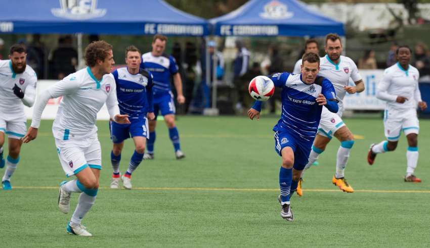 Miami FC's Mason Trafford, left, in action against FCE's Ben Fisk. PHOTO: TONY LEWIS/FC EDMONTON