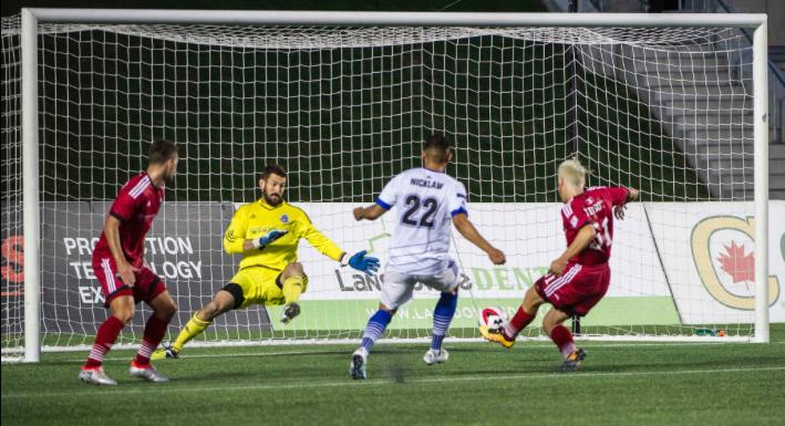Maxim Tissot scores his first NASL goal. PHOTO: STEVE KINGSMAN/NASL