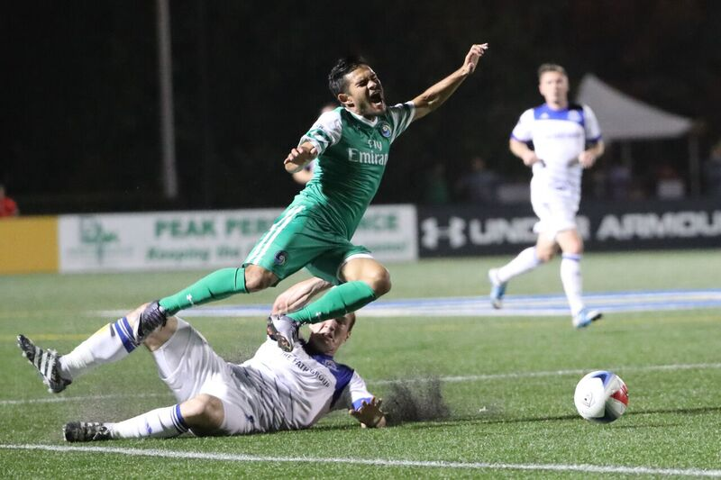 FCE defender Albert Watson got a yellow card for this challenge on New York's Andres Flores. PHOTO: NEW YORK COSMOS